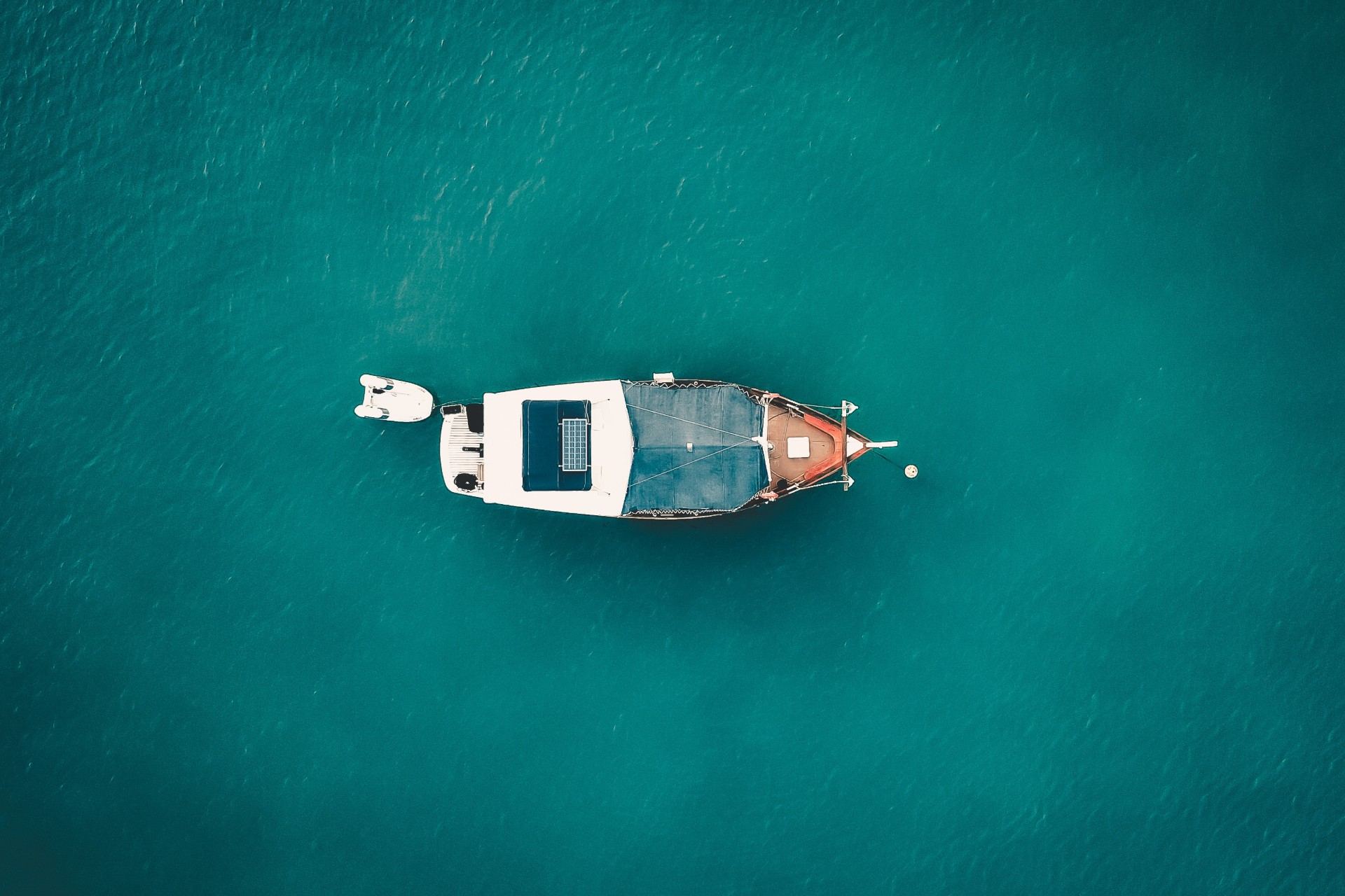 a small fishing boat on the blue bahamian waters
